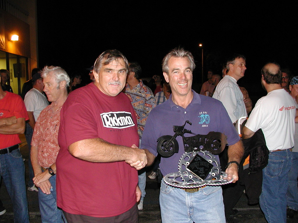 Ken Upton with the September winner and his hand made trophy