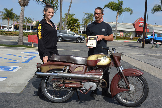 Baird Bergenthal of Midway City with his 1963 Batavus Bilonet along with Vanessa of Russ Brown Motorcycle Attorneys