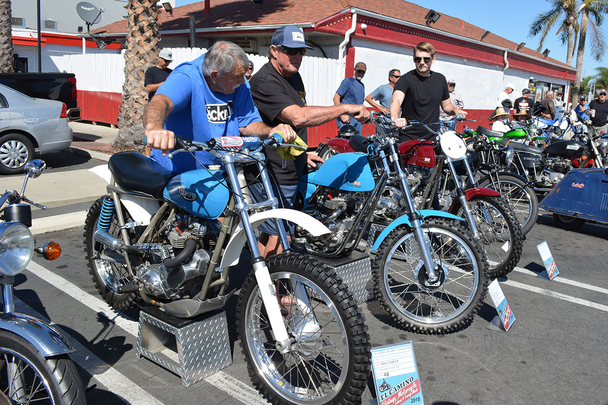 Ken Upton with three of his racing dirt bikes